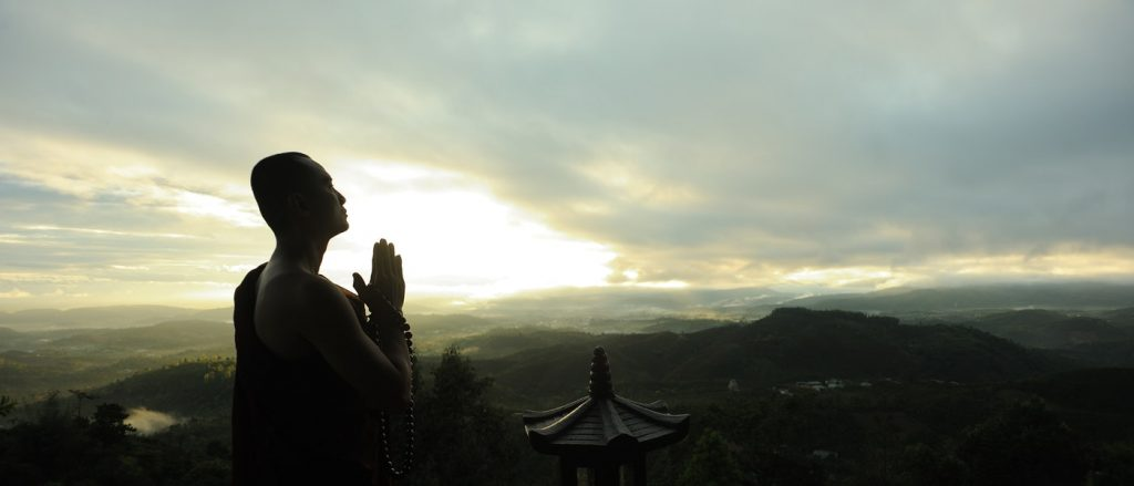 Monk Expressing Gratitude through prayer
